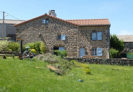 Ancient farm in a small village surrounded by volcanic landscapes Auvergne